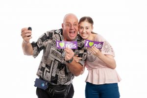QDN members holding I love the NDIS stickers