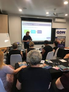 Paige Armstrong presenting to health professionals in Cairns about NDIS access.