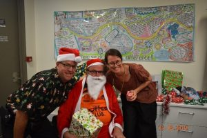 Members of the Hot Topics group celebrating Christmas with Santa