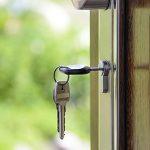 Keys in lock in front door of house