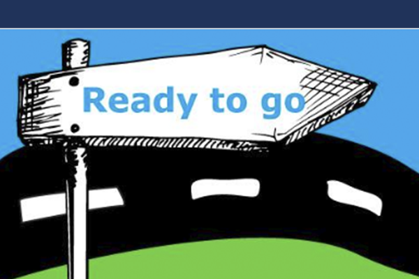 An illustrated street sign saying Ready to go, with a stylised blue sky, black road and green grass in the background.