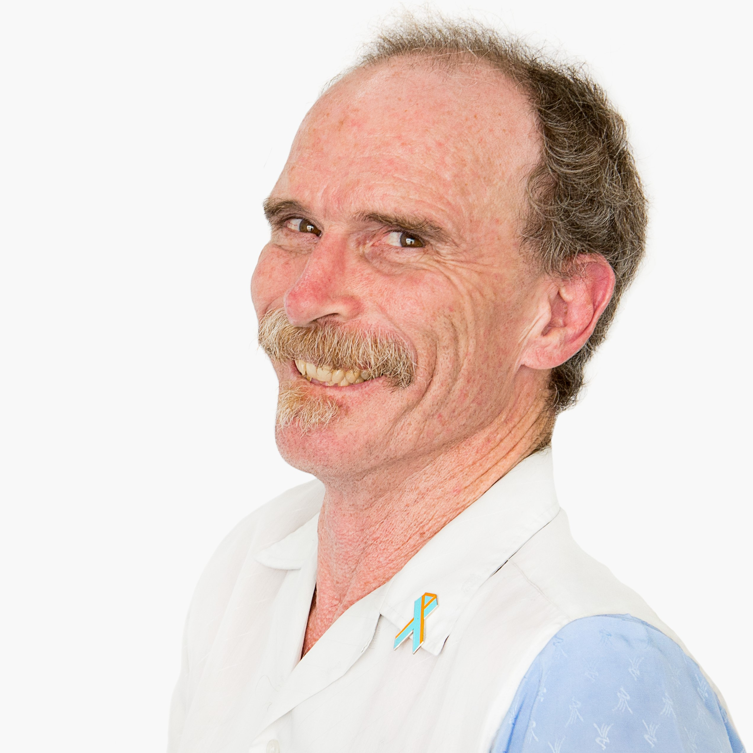 a photo of QDN board member John MacPherson, wearing a white and light blue polo and smiling at the camera.