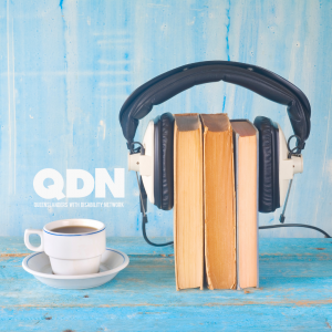 An aqua background with a coffee cup and next to that three books with headphones holding them together. QDN in white.