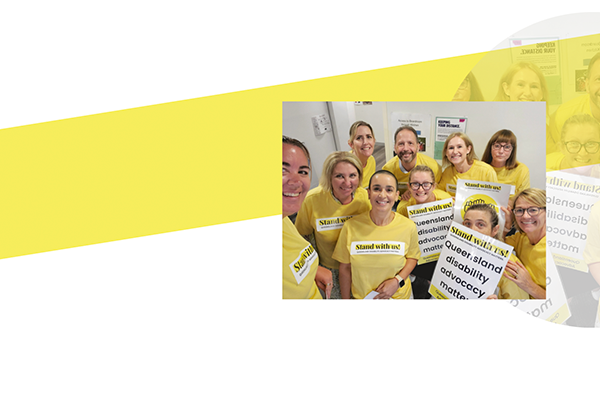Yellow strip with a photo of a group of people in yellow shirts holding Stand With Us! signs