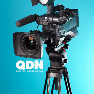 A large video camera with an aqua background and QDN in white.